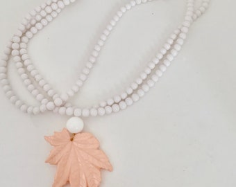 vintage white beaded necklace with leaf pendant
