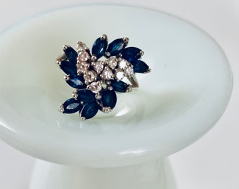 18k white gold, sapphire and diamond swirl ring