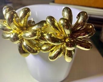 Statement golden flower statement earrings