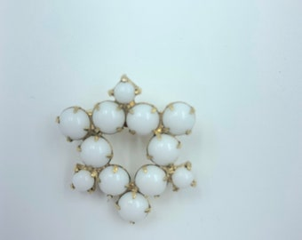 white and gold square brooch