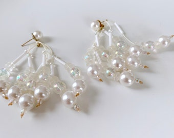 Statement multi strand white and pearl earrings