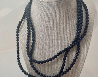 very long dark navy beaded necklace