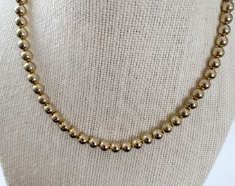 classic, elegant, simple goldtone bead necklace