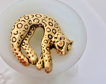 statement curled leopard brooch