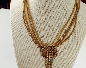 gold-tone multi-chain necklace with circle crystal pendant