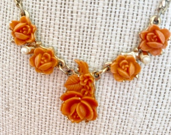 Sweet necklace with orange flowers and delicate faux pearls.