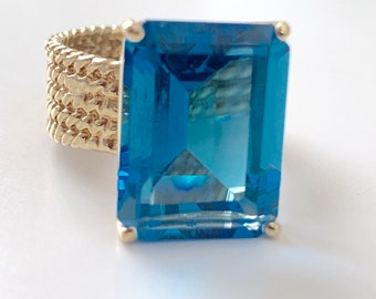 Blue topaz standout color engagement or statement ring