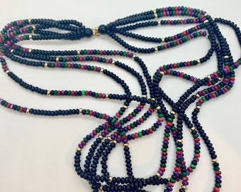 multi-strand black, gold, purple, green, red necklace