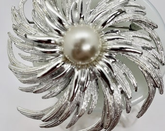 large silver swirl blossom with pearl center