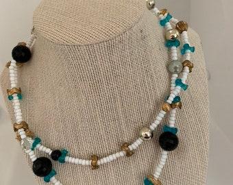 long black, aqua, white beaded necklace