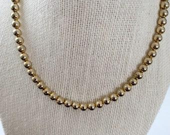 classic, elegant, simple goldtone bead necklace
