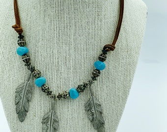 faux turquoise and sliver necklace - leather, feathers, beads - perfect boho statement