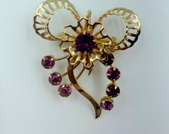 faux amethyst and gold bow brooch or pendant