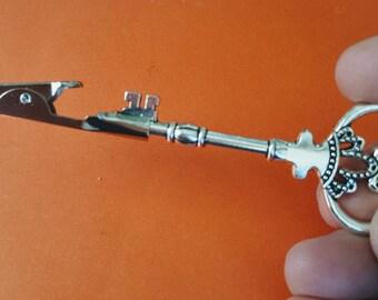 pink and black bat quartz roach clip 420 tool