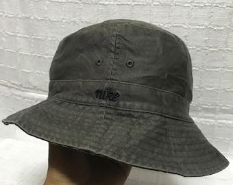 31f1a4b7ea2 nike bucket hat reversible tartan style