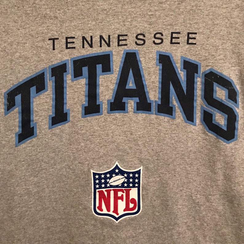 84e7bb30 Vintage Tennessee Titans graphic tee by Champion | Etsy