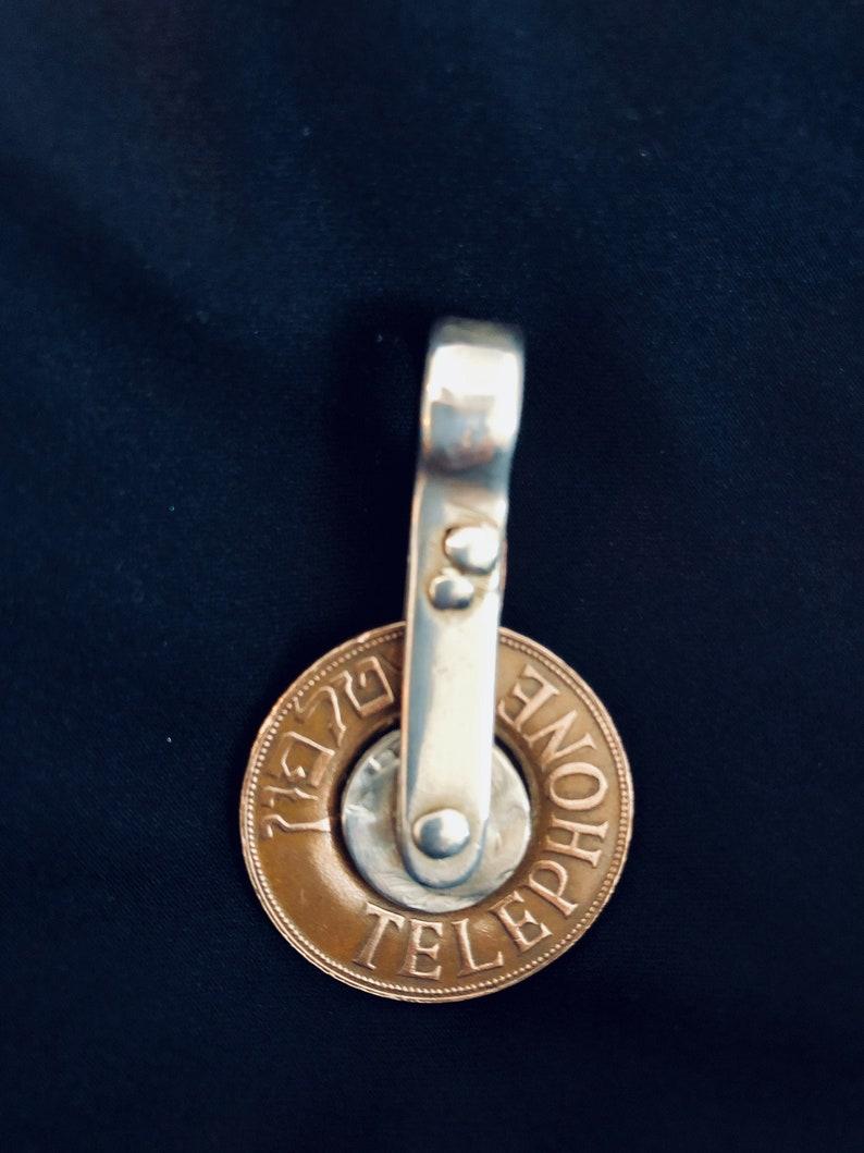 Antique Israeli telephone spinner pendant.