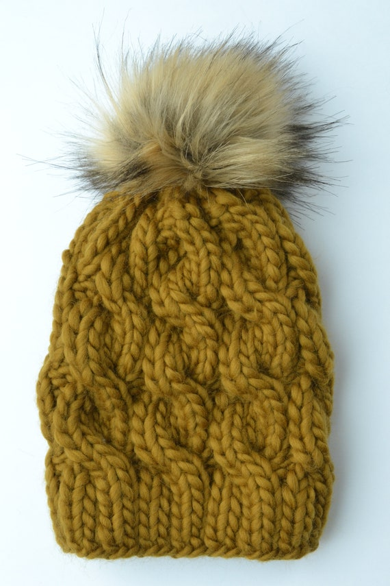 1060e297230 Bronze Cable Knit Wool Hat with Faux Fur Pom Pom