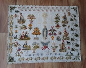Sampler, tapestry, needlework. French sampler, woolwork on backcloth with various trees, figures and animals all hand worked, stiched
