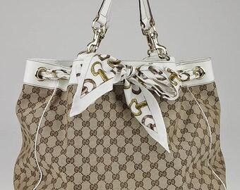 9d98cfe711f2 Vintage authentique Gucci Positano GG toile Beige ébène épaule Totebag Claf  peau cuir