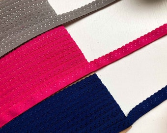 9m of pre-folded Fold-over Elastic with a pretty scallop edge. 3 colour kit - Grey - Fuscia - Navy. Sewing Supplies - Knicker making