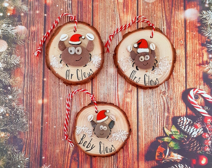 The Claws family... Christmas pebble art picture, log slice decoration for the tree.