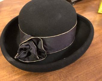 b16105fb863 Vintage Ladies Black hat flat with black gold edged ribbon wide curled brim