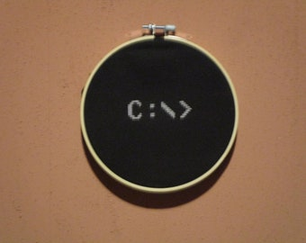 DOS C: prompt completed cross-stitch in hoop