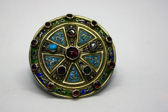 Silver brooch, enamel and gemstones