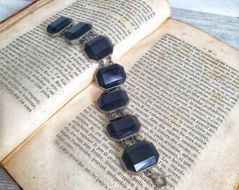 Vintage 1930s bracelet with black glass stones and silver frame
