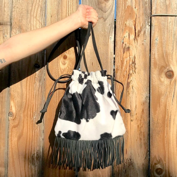 Fuzzy cow print cross body bag