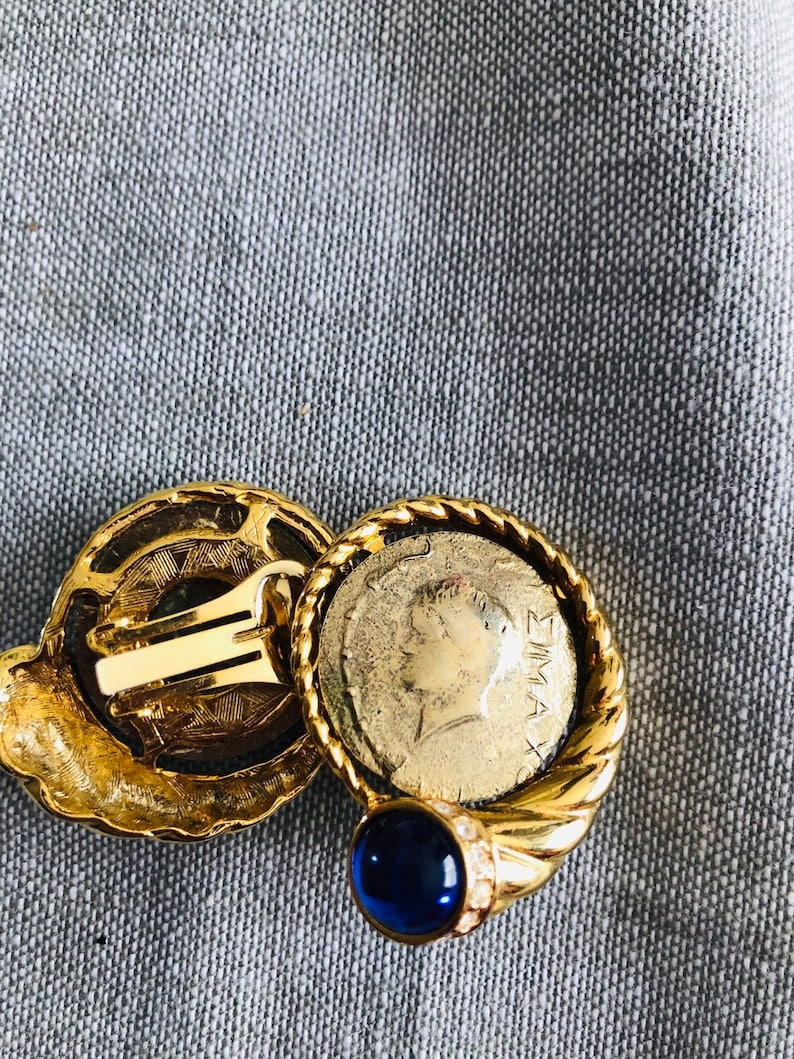 Gold Tone Greek Coin With Blue Jewel Clip on Earrings