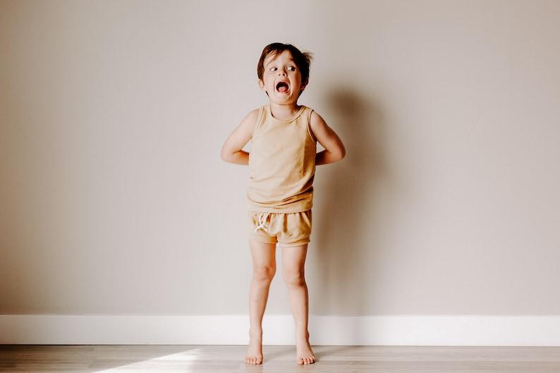 Boys On-trend pajama outfit for Babies and Girls. Get the Look Raglan Pj Top PAJAMA BUNDLE Pj Pants Racerback Pj Top