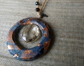 Blue ceramic circle pendant necklace in terracotta ceramic