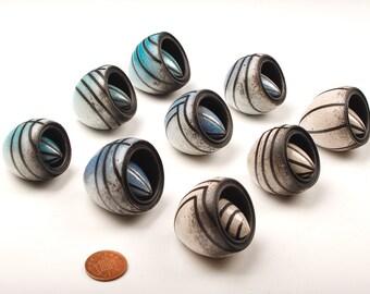 Miniature raku seedpods