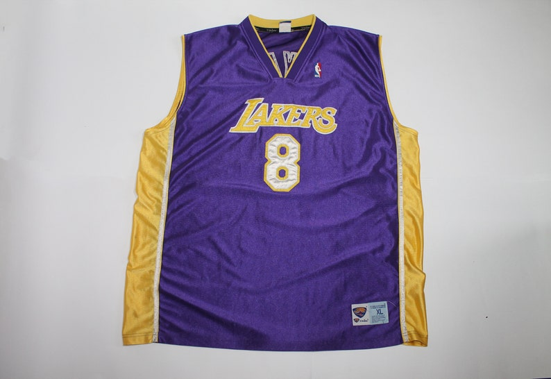 a8be102f6438 Vintage men s Kobe Bryant Authentic Purple Jersey  NBA Los