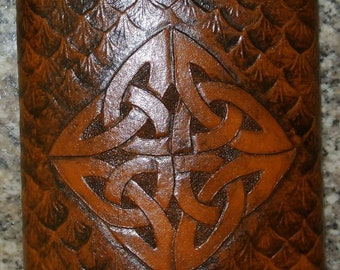 8 ounce stainless steel flask with a leather wrap that has a Celtic Knot work with Dragon Scales carved in it.