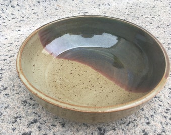 Green, red, and taupe serving bowl