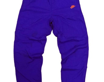 a461a55658f6 Rare Vintage 90s NIKE Neon Nylon Track Pants Embroidered Logo Streetwear  Hip Hop Skate Swag Small Size