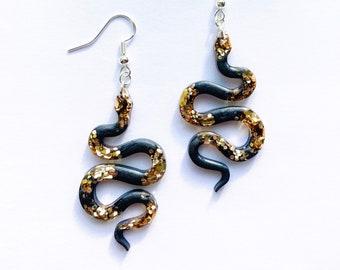 Black and Gold Glitter Snake Dangly Resin Earrings