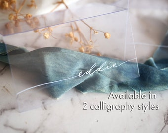 Handwritten Acrylic wedding/event place cards in modern bespoke calligraphy, on clear thin light acrylic plastic sheet.