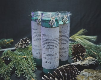 """nature [ l ä k a ] 8"""" intention candle - enhanced with organically sourced lobelia seeds and leaf charm"""