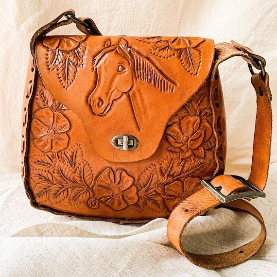 Vintage 1970s tooled leather bag