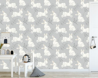 Bunny rabbit with cute cream rabbits and gray leaves on a gray background