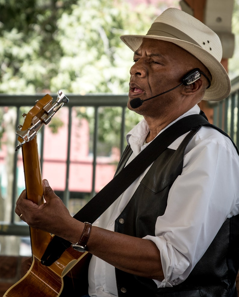 Man Playing Guitar and Singing, An Entertainer at the Park