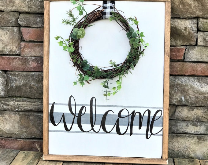 Framed wooden welcome sign with wreath, grain sack stripe, ticking stripe