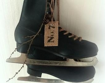 old black skates with patina decoration
