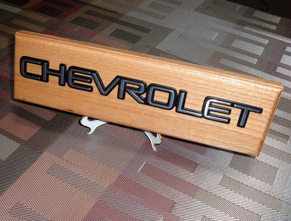 shop or man cave. Chevrolet RALLY SPORT Script Emblem Wall Plaque #AE-309 Unique automotive art with an original vehicle emblem for garage
