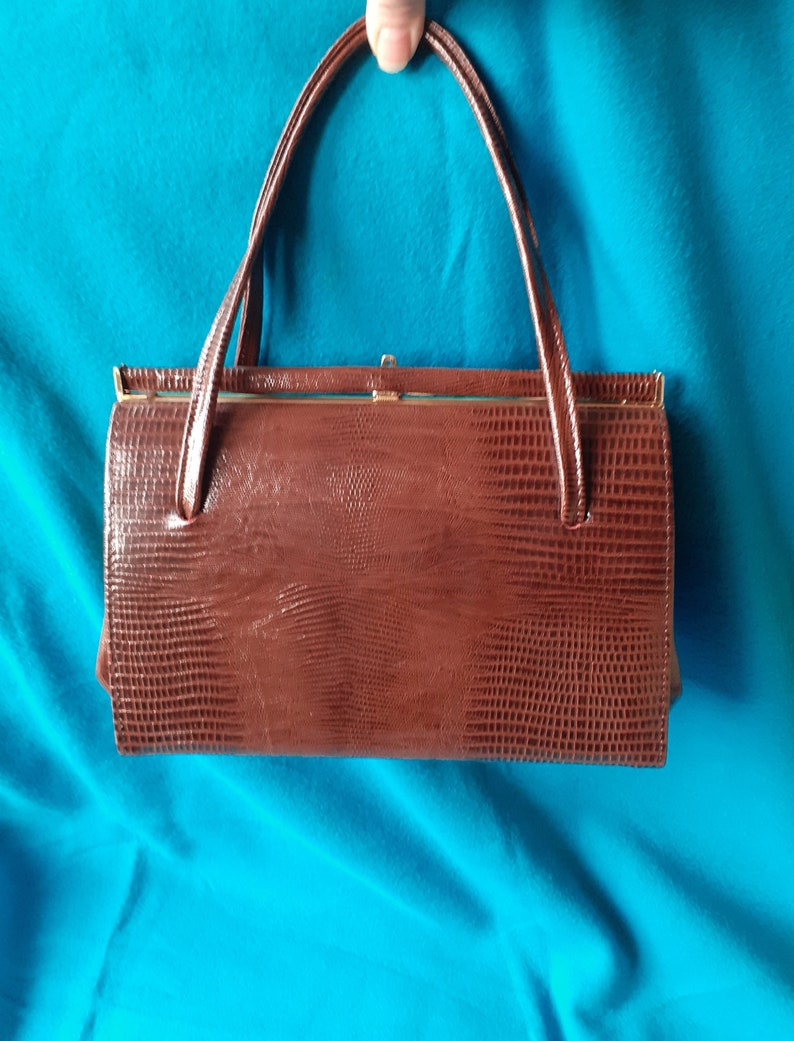 Suede lined. Vintage brown mock croc Kelly style handbag
