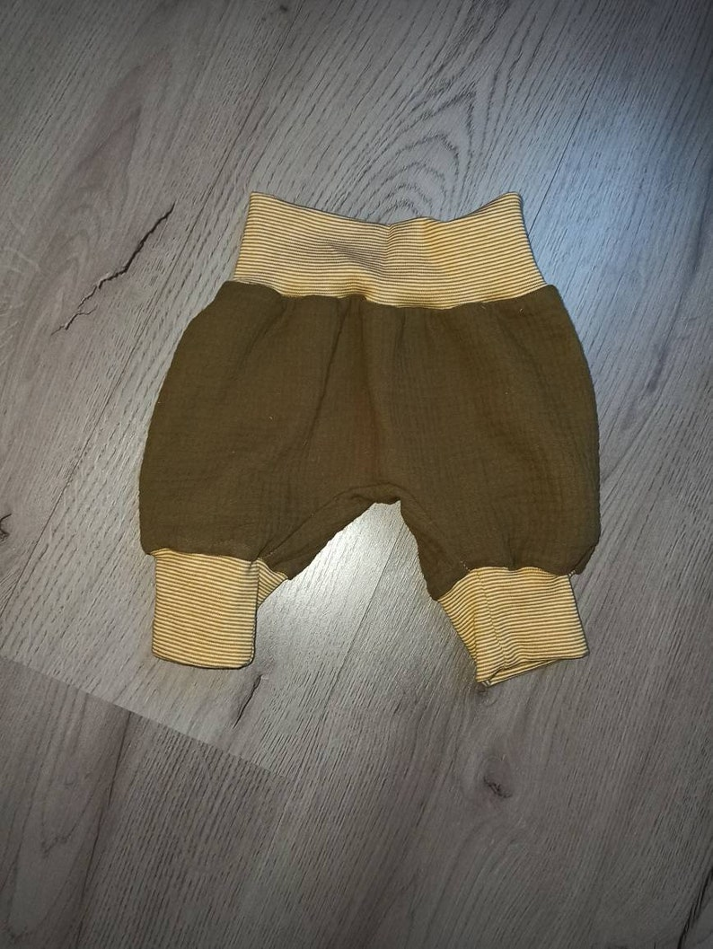 Pump pants made of muslin fabric  olive in desired size